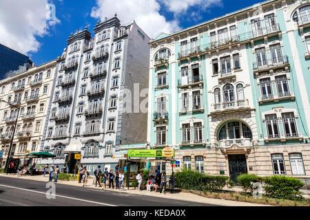 Lisbon Portugal Rua Braamcamp Hotel Expo Astoria building exterior bus stop shelter McDonald's advertising city - Stock Photo