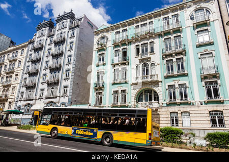 Lisbon Portugal Rua Braamcamp Hotel Expo Astoria building exterior bus public transportation stop city skyline residential - Stock Photo