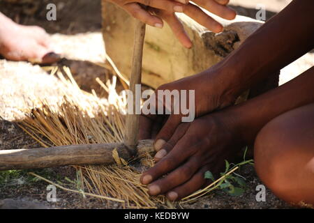 Buschmänner San people in Namibia - Volksstamm - making fire - Stock Photo