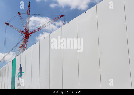 A cane above a wall with the Taisei Construction company name and logo on it at the construction site of the new - Stock Photo
