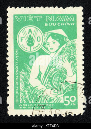 A postage stamp printed in VIETNAM  shows World food day , circa 1980 - Stock Photo
