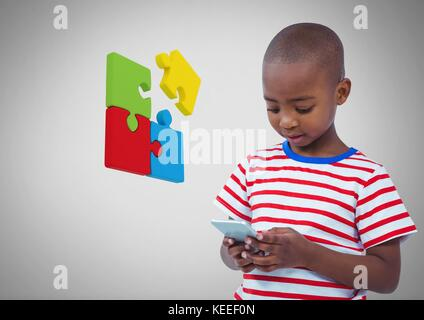 Digital composite of Boy against grey background with phone device and jigsaw puzzle pieces - Stock Photo