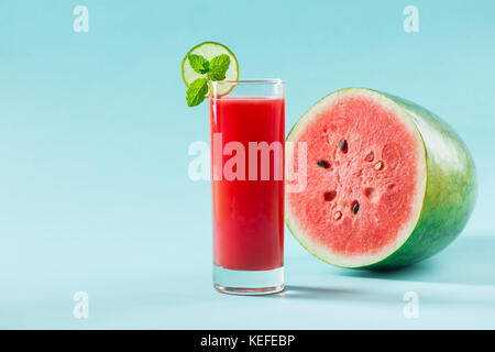Healthy watermelon smoothie on blue background - Stock Photo