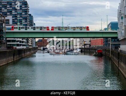 tram on road bridge over river Cologne Germany - Stock Photo