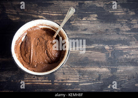 Basic homemade brownie or chocolate cake raw dough in bowl. Cooking (baking) homemade chocolate cake or brownie. - Stock Photo
