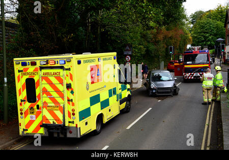 Emergency services (ambulance and fire engine) at the scene of a road traffic accident, Haslemere, Surrey, UK. Saturday - Stock Photo