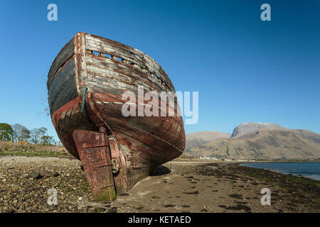 Abandoned boat on the shore of Loch Linnhe at Corpach. - Stock Photo