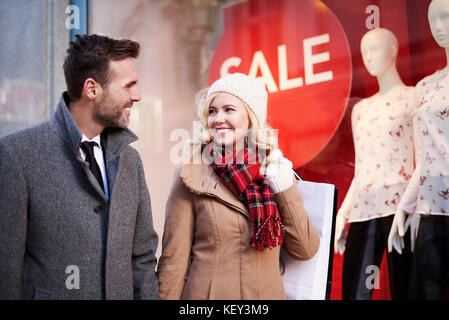Couple walking in the mall passage - Stock Photo