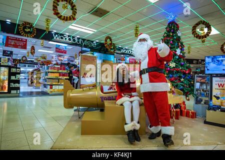COLOMBO, SRI LANKA - DECEMBER 2016: Santa Claus greets people in Bandaranaike International Airport - Stock Photo