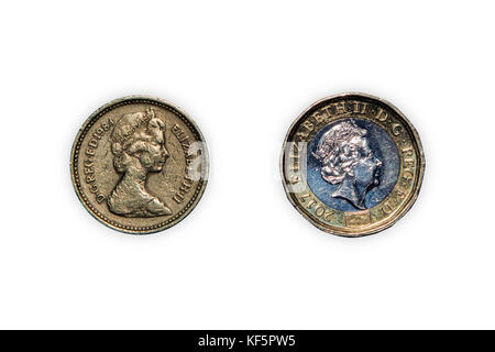 Close-up of old UK one pound coin (1984) and new one pound coin (2017) on a white background - Stock Photo