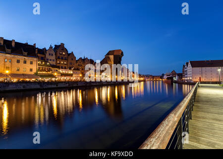 Scenic view of a promenade, lit Crane and other old buildings along the Long Bridge waterfront at the Main Town - Stock Photo