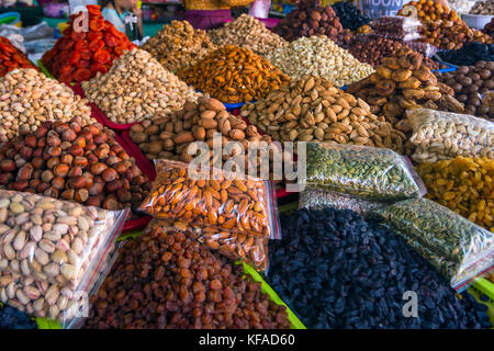 Nuts, almonds, dry fruits and pumpkin seeds at the market in Bishkek - Stock Photo