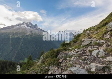 Aiguille du Dru and Aiguille Verte seen from rock footpath leading to Lacs De Cheserys, Argentiere, Haute Savoie, - Stock Photo