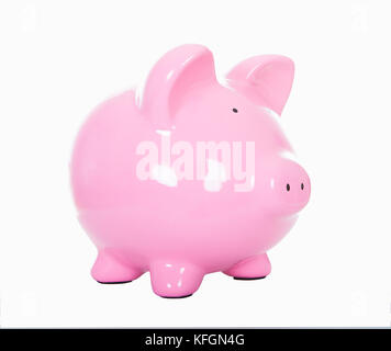 Pink ceramic piggy bank isolated on white in an angled side view conceptual of finances and saving - Stock Photo