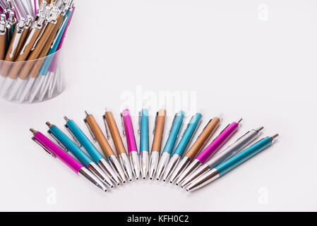 Colorful pens in half circle on the white background - Stock Photo