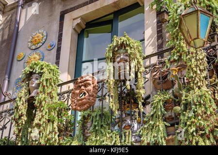 Characteristic balcony decorations in Taormina, Sicily, Italy - Stock Photo