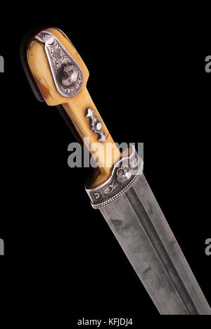Part of beautiful example of caucasian dagger with ornament grip and blade from Damascus steel. (1907). Dag(h)estani - Stock Photo