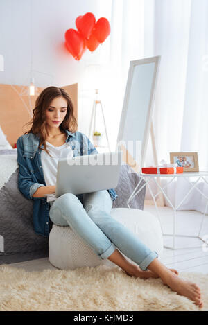 Beautiful lady in casual working on laptop - Stock Photo
