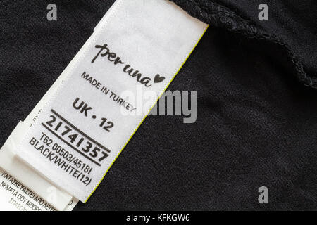 per una label in woman's clothing made in Turkey size 12 - sold in the UK United Kingdom, Great Britain - Stock Photo
