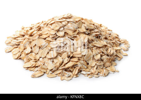 Pile of dry rolled oatmeal isolated on white - Stock Photo