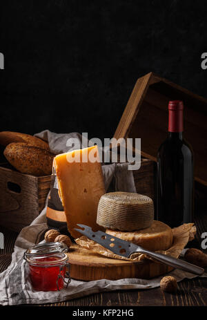 Composition with cheese, bread and wine - Stock Photo
