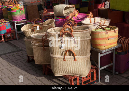 Coloured baskets on a market stall in a French Market in the UK - Stock Photo