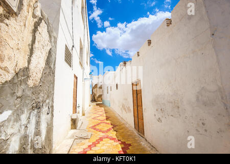 Cityscape with narrow street in Medina of Kairouan. Tunisia, North Africa - Stock Photo