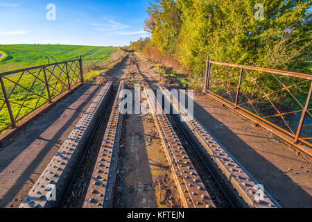 Steel girder bridge remaining on disused / removed railway line - France. - Stock Photo