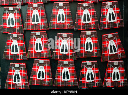 Geometric view of fridge magnets in shape of Scottish kilts for sale in tourist gift shop on the Royal Mile in Edinburgh, - Stock Photo