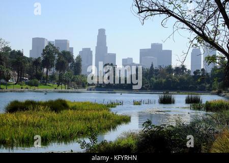 Skyline view of Los Angeles downtown office buildings looking across Echo Park Lake in autumn heatwave LA California - Stock Photo