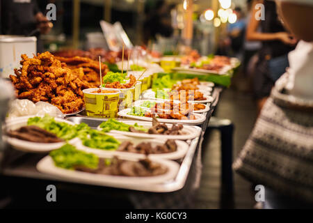 Fried chicken stall in local Thai street market - Stock Photo