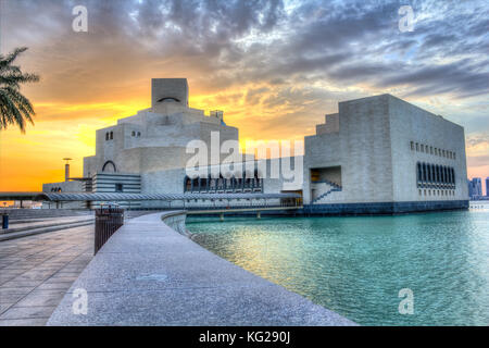 Museum of Islamic Art , Doha,Qatar in daylight exterior view with Arabic gulf in the foreground and clouds in the - Stock Photo