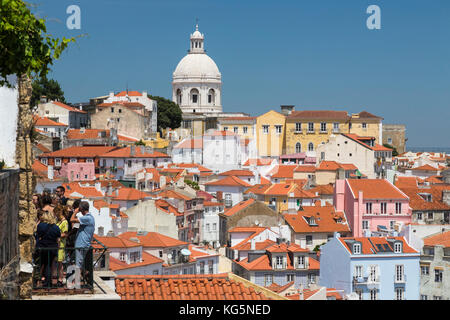 Terracotta roofs and the ancient dome seen from Miradouro Alfama one of the many viewpoints of Lisbon Portugal Europe - Stock Photo
