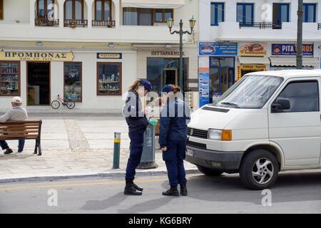 Greek traffic police writing a ticket for a car at no waiting, Naxos-town, Naxos island, Cyclades, Aegean, Greece - Stock Photo