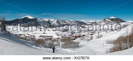 Crested Butte Mountain Resort base area from 'The Waterfall' area on International ski trail. - Stock Photo