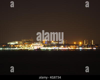 Sheerness, Kent, UK. 4th Nov, 2017. The bright lights of Southend on sea, Essex as seen from Sheerness on a cloudy - Stock Photo