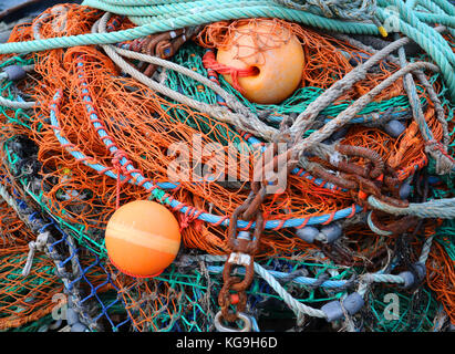 Pile of Fish Nets Buoys and Chains Close Up - Stock Photo