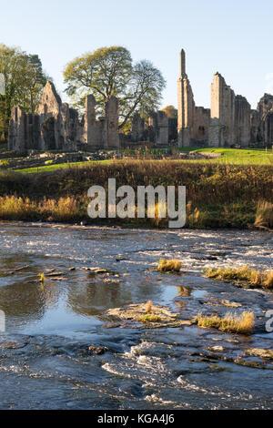 Autumn view of Finchale Priory, seen across the river Wear, Co. Durham, England, UK - Stock Photo