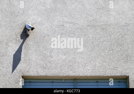 CCTV security camera on building - Stock Photo