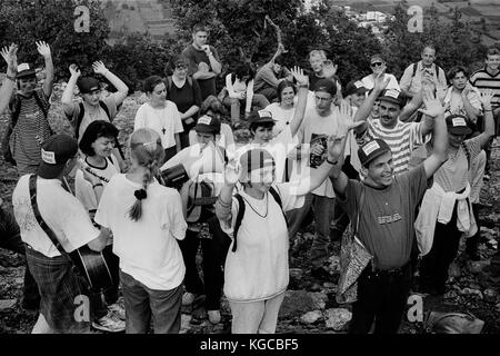 Catholic Pilgrims pray at Medugorje in Bosnia-Herzegovina where a number of young adults say that they had visions - Stock Photo