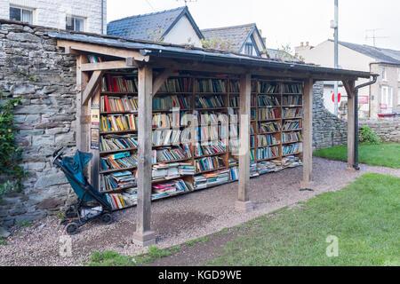 Bookshelves outdoors at Hay Castle Honesty Bookshop - Stock Photo