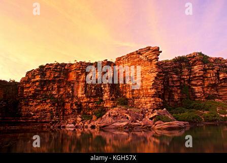 Sandstone escarpment meets the Kimberley coast, mangroves border the tidal zone. North Kimberley region, Western - Stock Photo