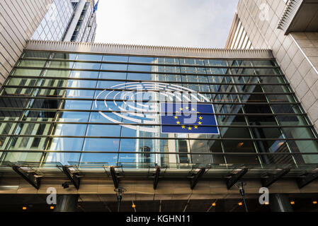 Brussels, Belgium - August 28, 2017: Facade of the modern office buildings of the European Parliament with the euro - Stock Photo