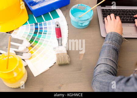Interior design, renovation and decoration concept - woman working with color samples for selection - Stock Photo