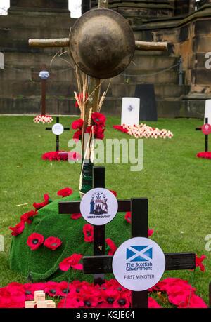 Edinburgh, Scotland, United Kingdom, 8th November 2017. Close up of  poppy crosses with Scottish Government First - Stock Photo