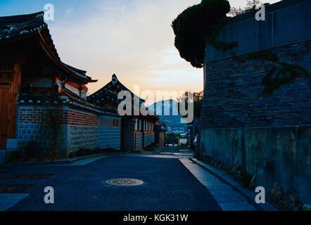 Bukchon hanok village in sunset - Stock Photo