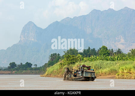 Karst mountains and wooden dredger boat dredging the Salween river / Thanlwin river near Hpa-an, Kayin State / Karen - Stock Photo