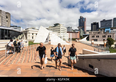WELLINGTON, NEW ZEALAND - MARCH 1, 2017: People walk in the pedestrian area in fron of the city hall in downtown - Stock Photo