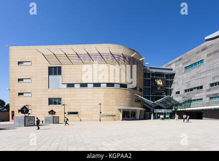 WELLINGTON, NEW ZEALAND - MARCH 1, 2017: People walk toward the entrance of of the Museum of New Zealand Te Papa - Stock Photo