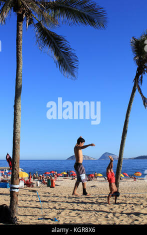 Walking on Hands and Tightrope in Copacabana - Stock Photo